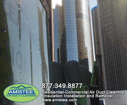 Amistee vacuum trucks cleaning downtown office building